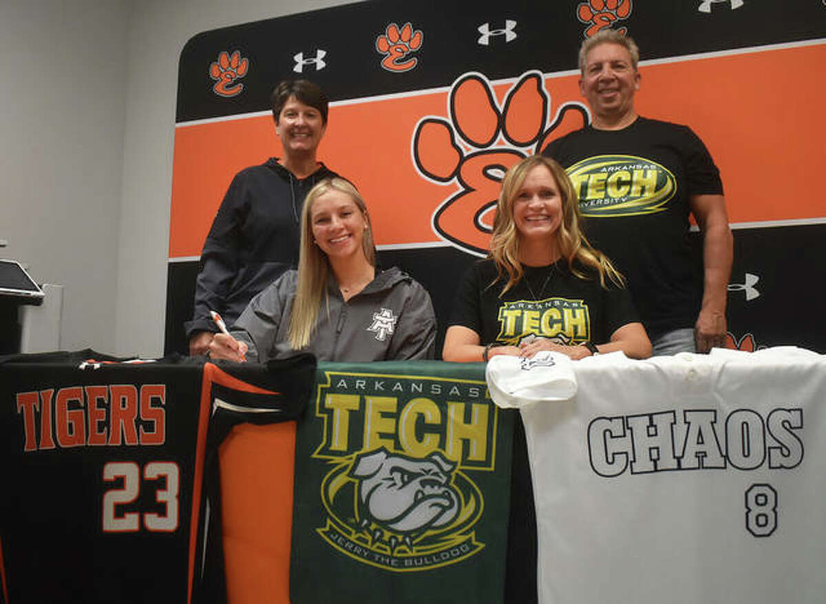 EHS senior Lexi Gorniak, seated left, will play college softball at Arkansas Tech University. She is joined by her parents and EHS coach Lori Blade.