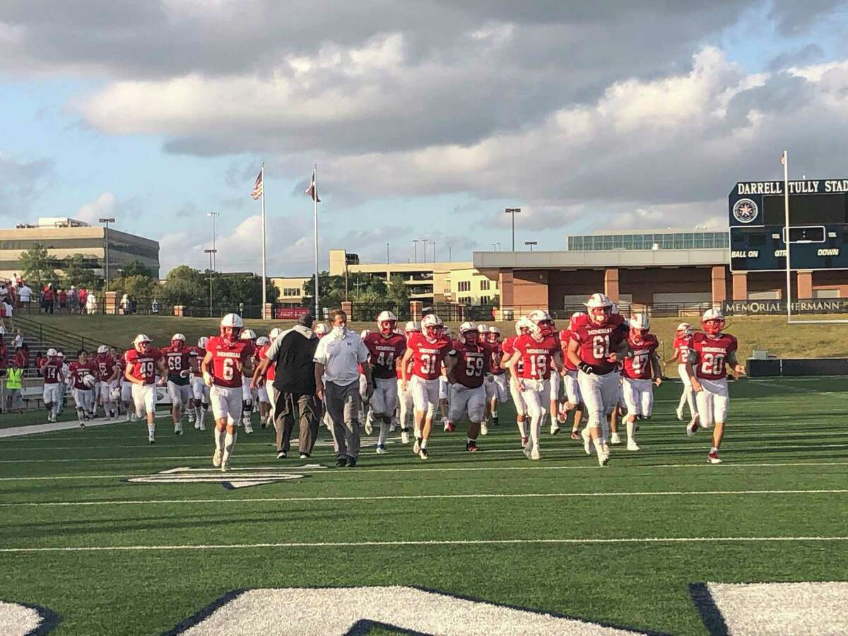 The Memorial Mustangs run off the field at Darrell Tully Stadium after beating the Cy Creek Cougars 17-7 on Nov. 14