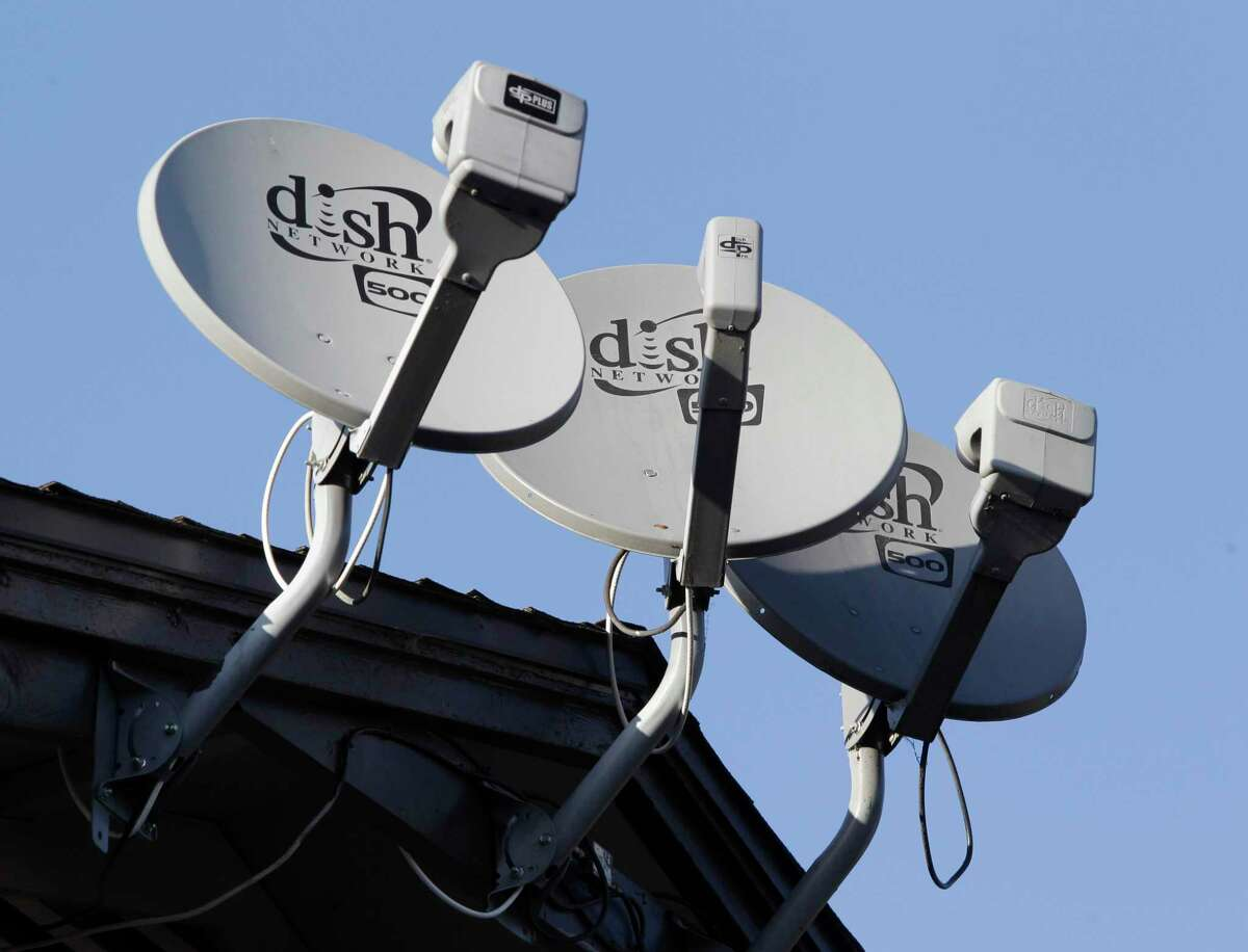 FILE - This Feb. 23, 2011 file photo shows three Dish Network satellite dishes at an apartment complex in Palo Alto, Calif. Dish is working to become a new major wireless carrier to challenge AT&T, T-Mobile and Verizon.