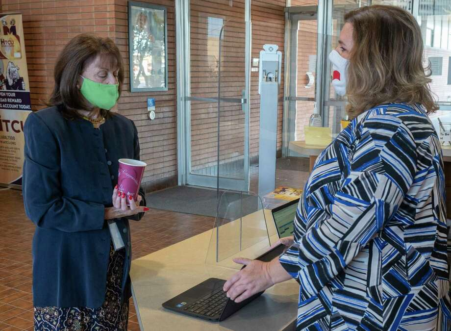 Kellie Spencer, right, MISD Chief Operating Officer, shows MISD interim Superintendent Ann Dixon the list of classes that still need substitutes 11/16/2020 morning as MISD administration personnel sign up to sub in classrooms. Tim Fischer/Reporter-Telegram Photo: Tim Fischer, Midland Reporter-Telegram