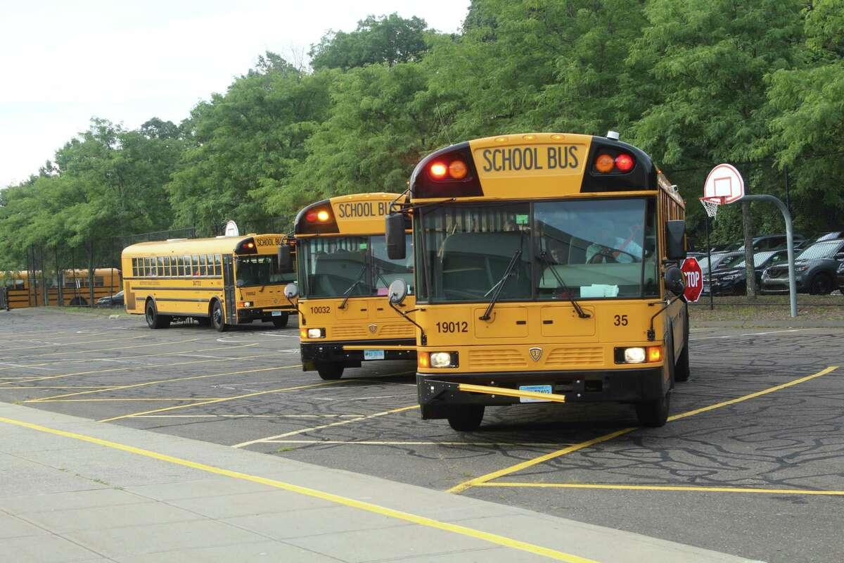School buses arrive at Bedford Middle School to kickoff the 2019 school year in Westport. Taken Aug. 27, 2019 in Westport, CT.