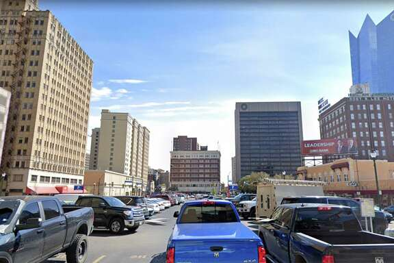 Weston Urban is planning to build a 32-story tower with apartments and retail space on a parking lot downtown.