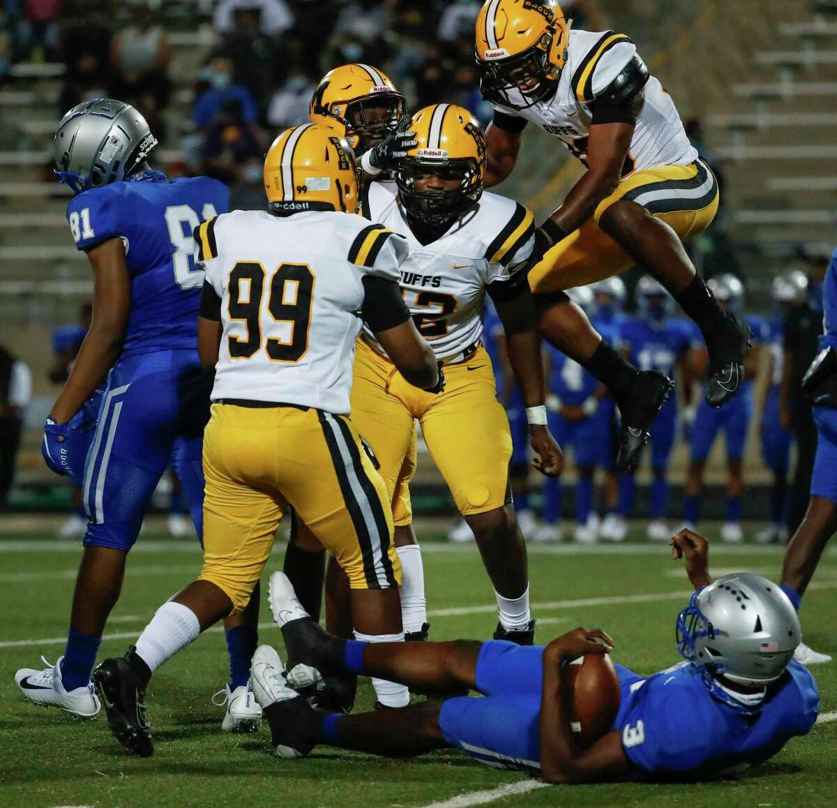 Fort Bend Marshall defensive end Zachary Chapman (42) celebrates with his teammates after sacking Willowridge quarterback Rufus Scott for a loss during an 11-5A matchup at Hall Stadium Thursday, Nov. 12, 2020 in Missouri City.