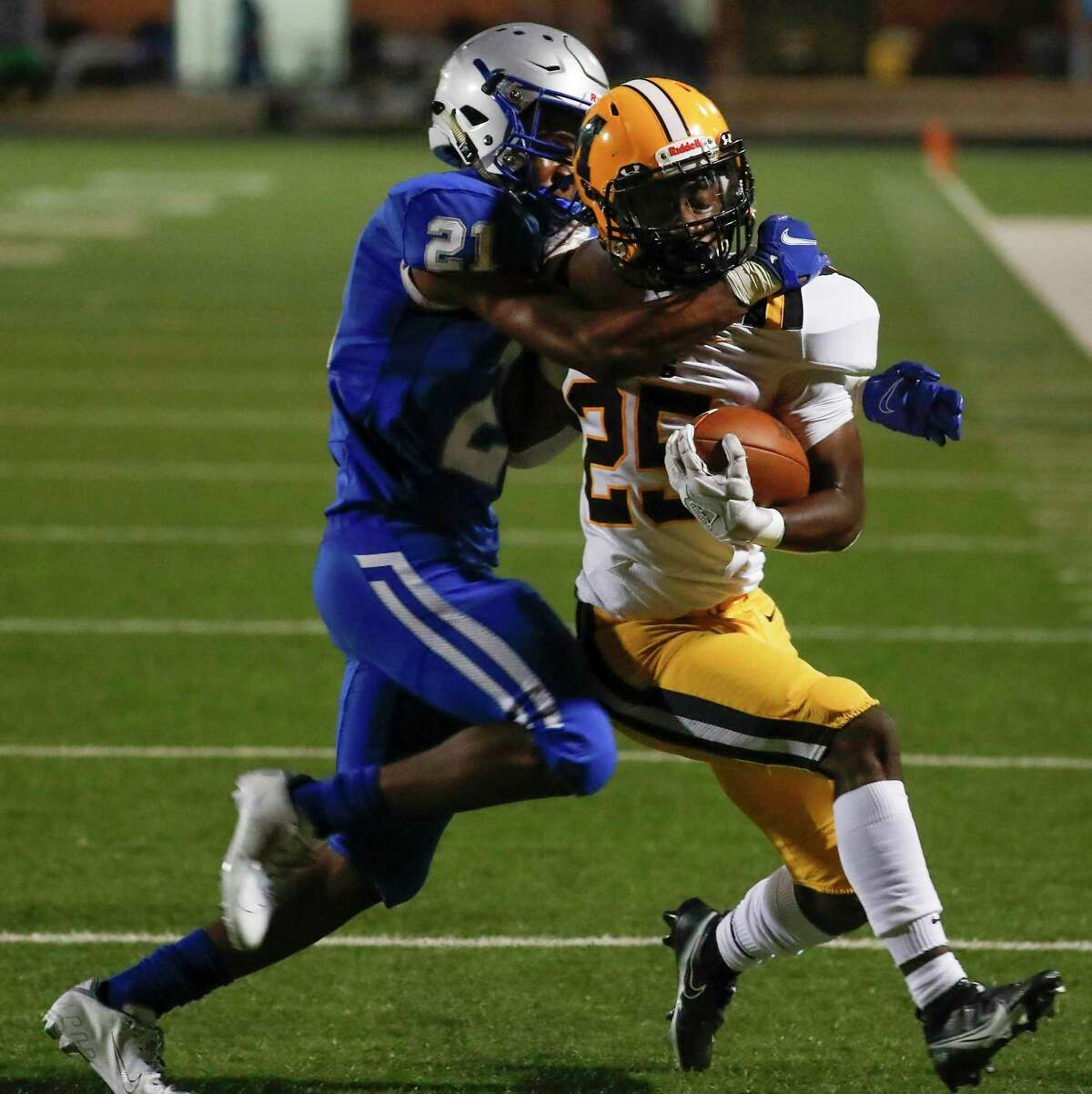 Willowridge defensive back Kaleb Williams (21) stops Fort Bend Marshall running back Aaron McGowen (25) just short of the goal line during an 11-5A matchup at Hall Stadium Thursday, Nov. 12, 2020 in Missouri City.