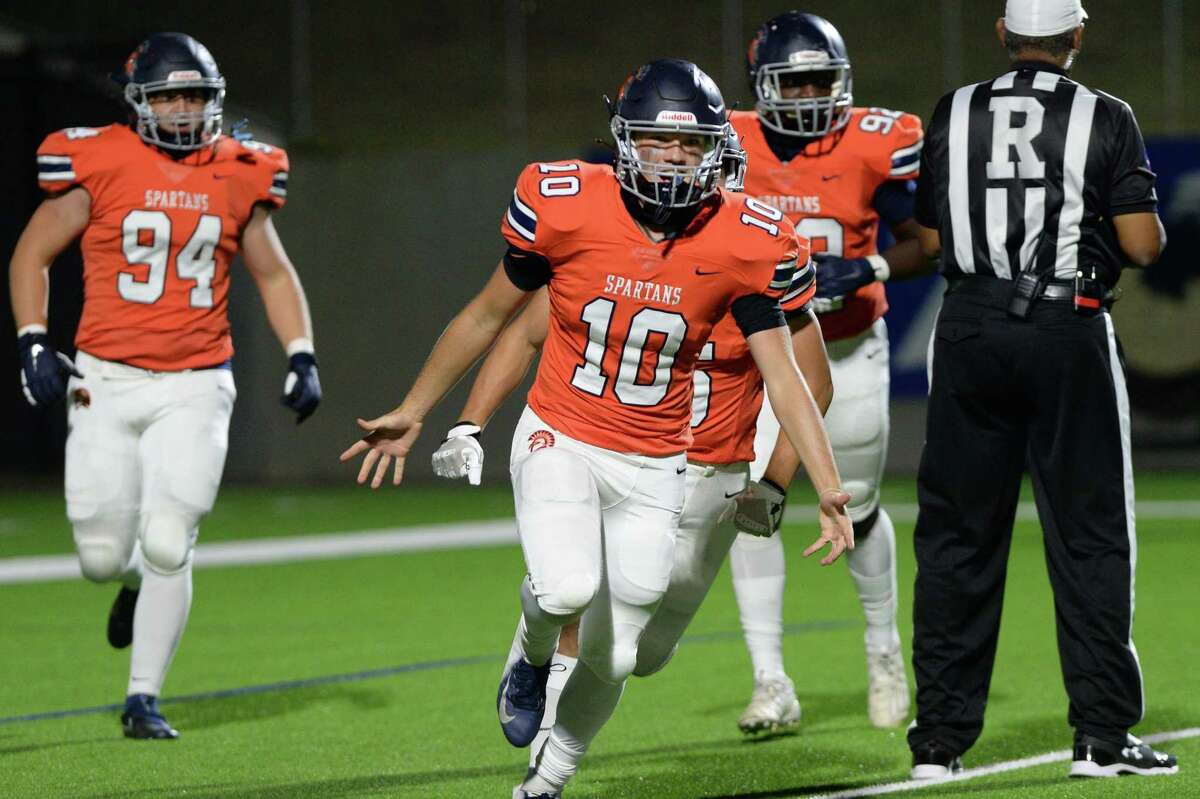 Scott Stanford (10) of Seven Lakes reacts after recovering a muffed punt and scoring a touchdown during the first half of a 19-6A football game between the Mayde Creek Rams and the Seven Lakes Spartans on Friday, November 13, 2020 at Legacy Stadium, Katy, TX.