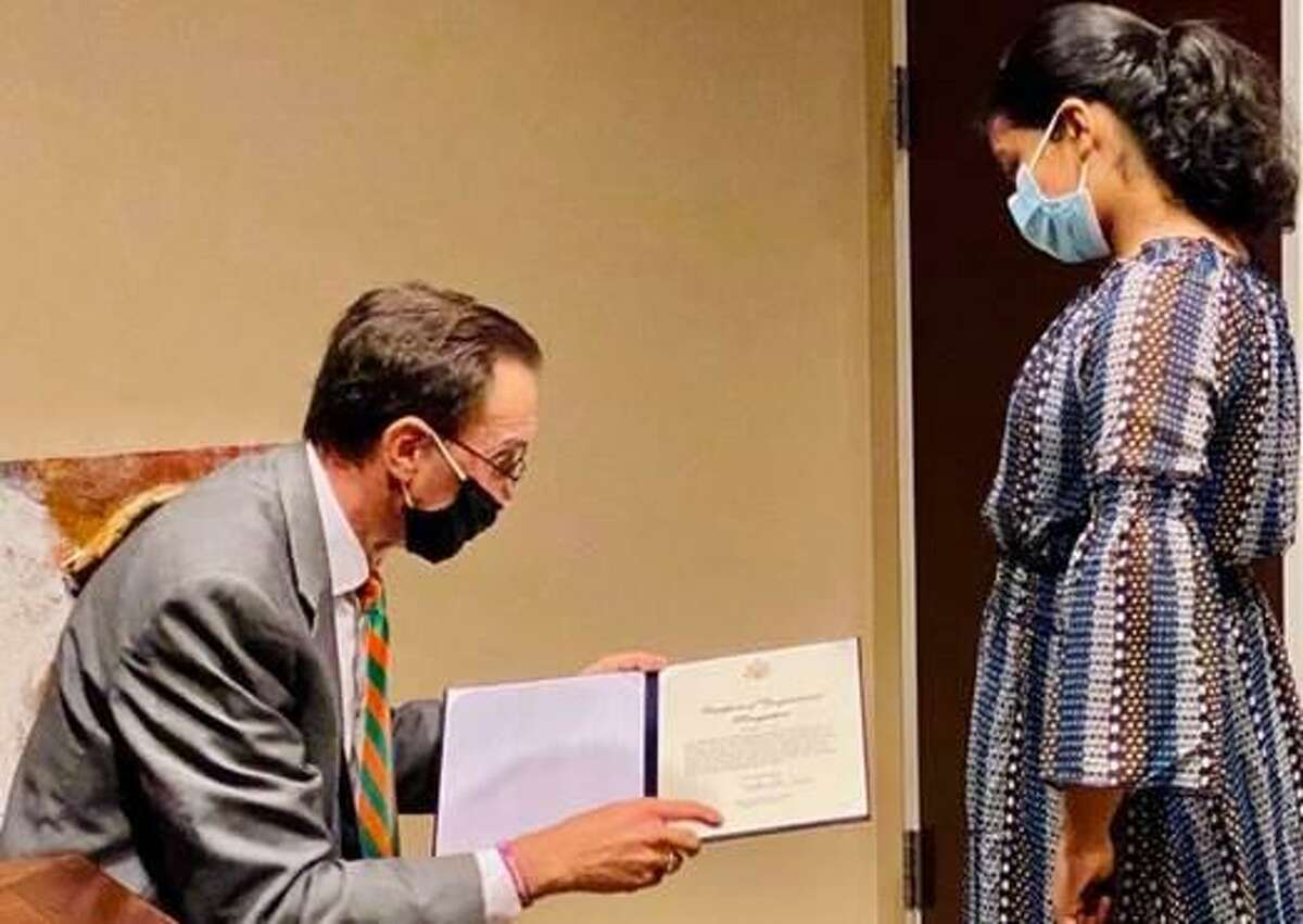 Missouri City-resident Tavishi Sinha, (pictured at right) received a certificate of congressional recognition from Congressman Pete Olson (left) on Nov. 4 honoring her as the winner of the 2020 Congressional App Challenge. Sinha, 12, is a seventh-grader at Quail Valley Middle School.