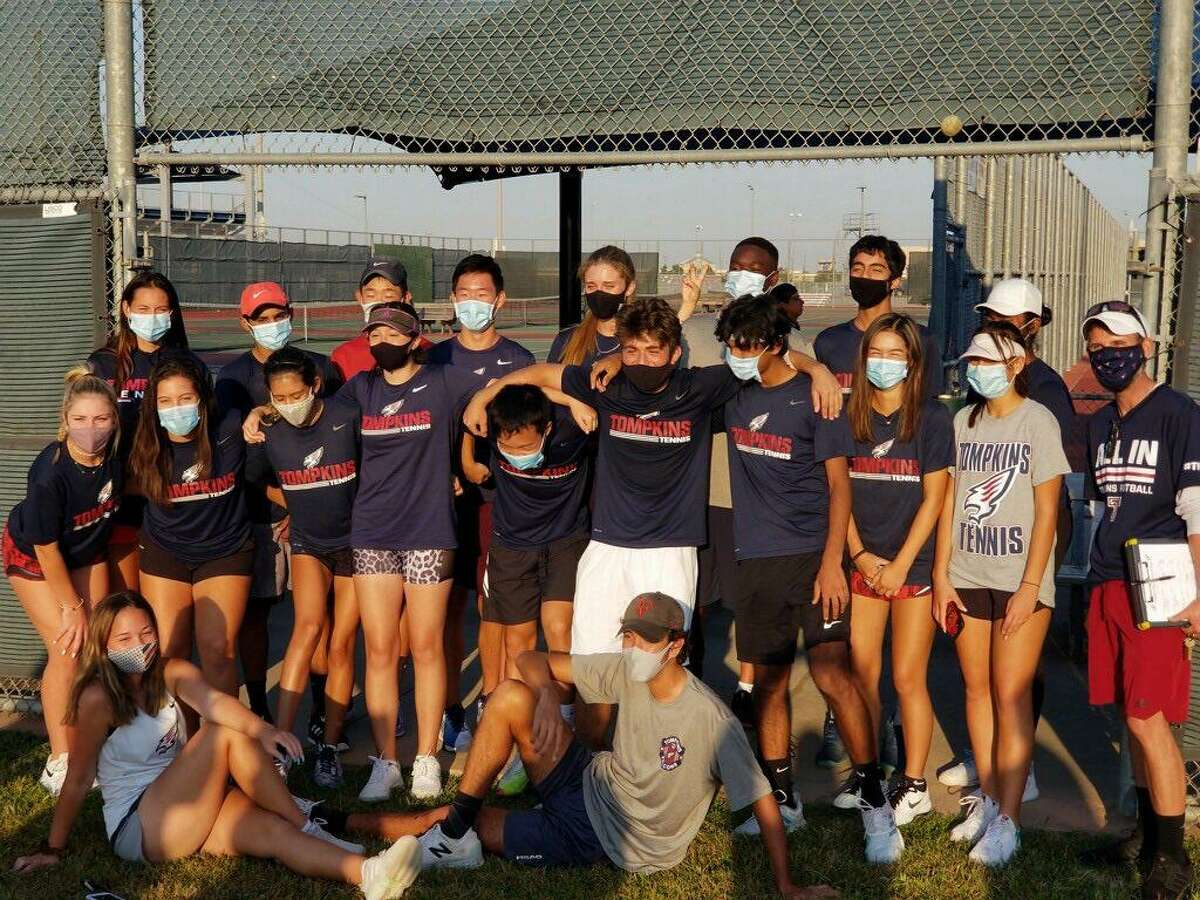 The Tompkins tennis team celebrates its Region III-6A semifinal victory against Clear Lake. The Falcons finished 14-1 and reached their first regional championship match.