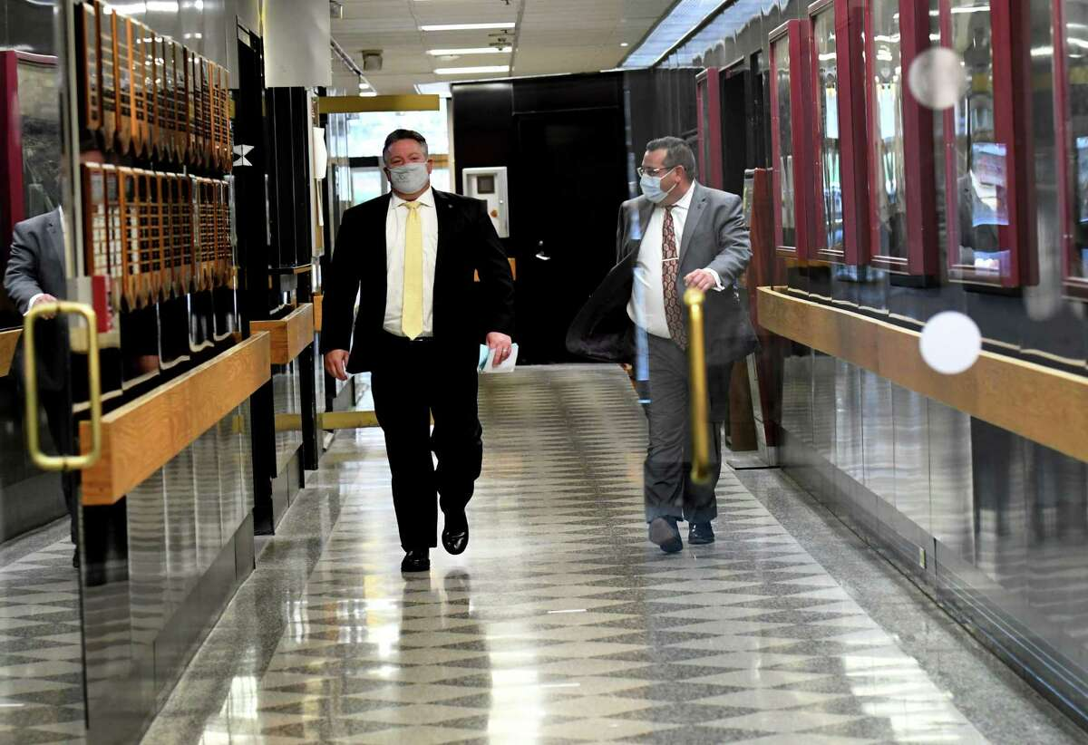 Albany County Executive Dan McCoy, left, heads to the Cahill Room to deliver the latest Albany County coronavirus news briefing on Monday, Nov. 16, 2020, at the county offices in Albany, N.Y. (Will Waldron/Times Union)