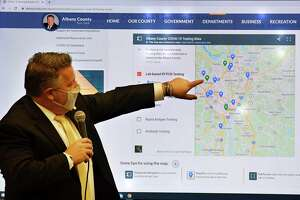 Albany County Executive Dan McCoy demonstrates the county's new COVID-19 testing site resource page during a morning coronavirus news briefing on Monday, Nov. 16, 2020, at the county offices in Albany, N.Y. (Will Waldron/Times Union)