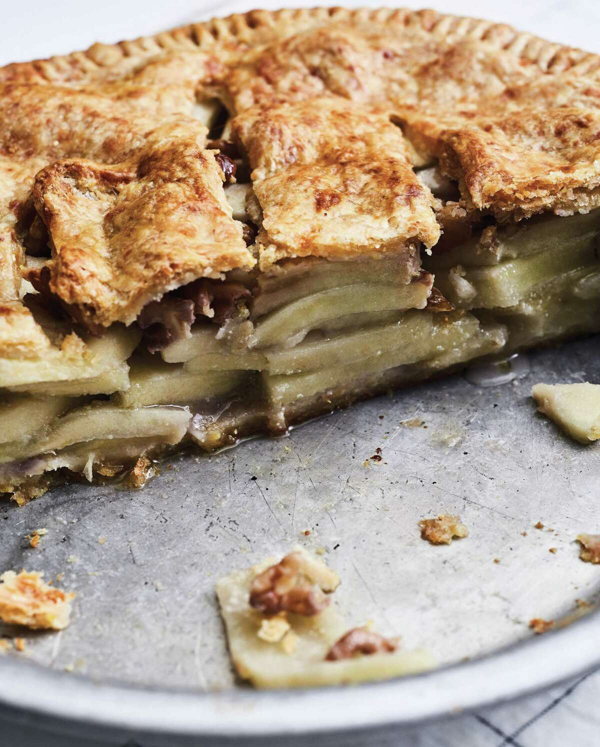 Cheddar-Crusted Apple Pie (recipe in column): New Englanders have known the pleasures of combining apple pie and cheddar cheese for a long time.