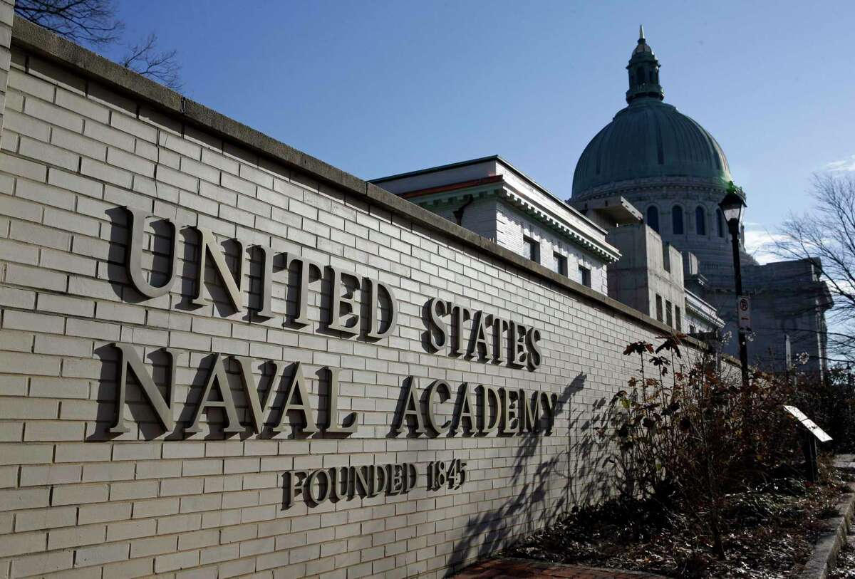This file photo shows a sign outside of an entrance to the U.S. Naval Academy campus in Annapolis, Md.