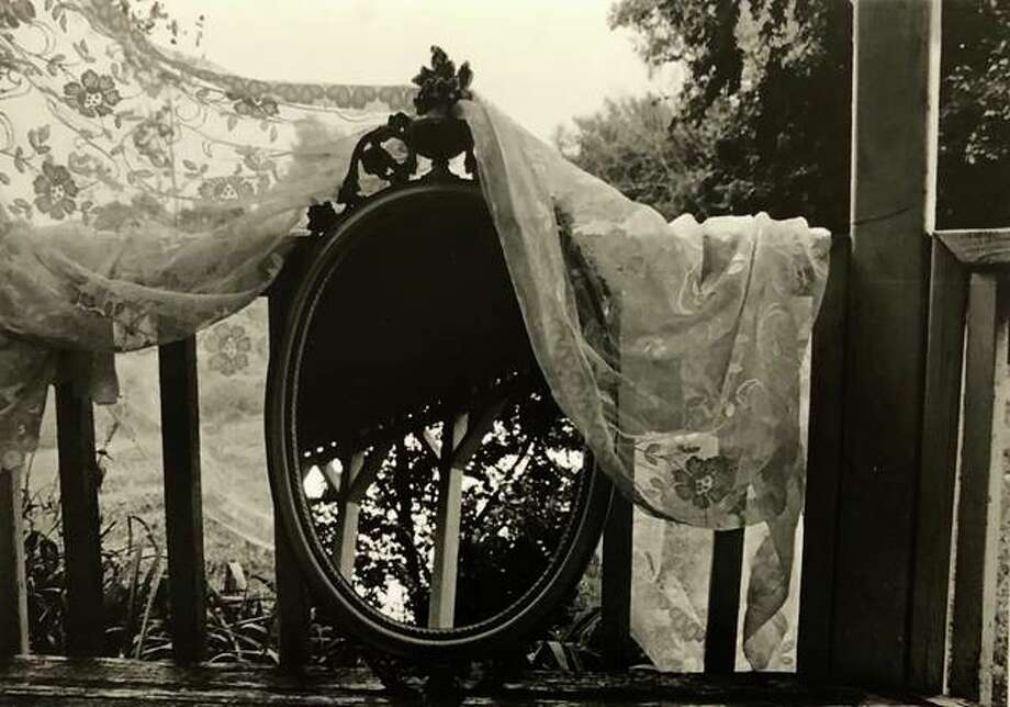 """A photo print by L&C student Morgan McGuire titled """"Mirror, Mirror"""" recently placed second at Wood River Heritage Council's Small Works Art Competition."""
