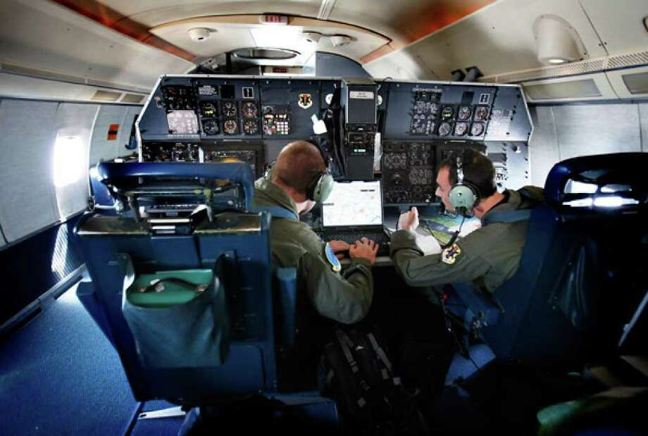 "1st Lt. Jesse Evans (left) and 2nd Lt. Pete Stanulonis check a map on a computer during a navigational training flight at Randolph AFB of the U.S. Air Force T-43 ""Gator,"" which will be retired Sept. 17."