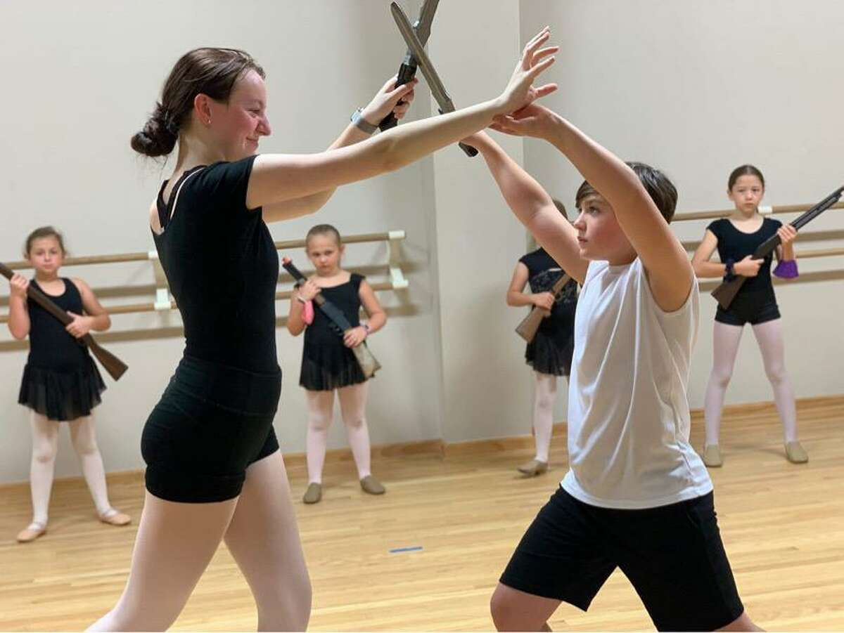"""Hannah Coleman as the Mouse Queen and Bryson Stephens as the Nutcracker in Backstage Dance Studio's """"Nutcracker."""" The show is set for Saturday at 2 p.m. and 5:30 p.m. at Montgomery High School."""