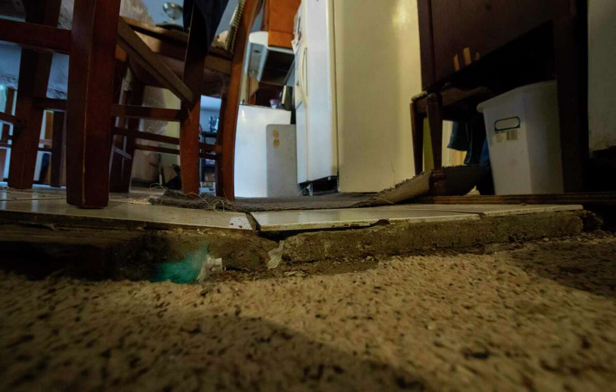 At one point a contractor installed beams under the home of Valeria Tamez to help level it after being damaged in Harvey. The work soon failed and now the floor in the house is sunken and uneven throughout, Friday, Nov. 13, 2020, in southeast Houston. Tamez was recently notified by the city that her application for housing relief would have to move from the city's program to one being run by the state's General Land Office.