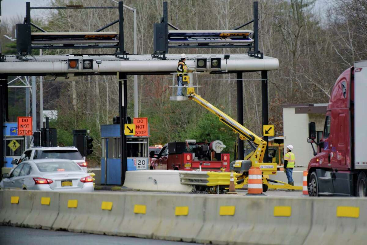 Workers are beginning the setup for the process to begin of dismantling the toll booths at exit 25 at the Interstate 890 and Interstate 90 on Monday, Nov. 16, 2020, in Schenectady, N.Y. (Paul Buckowski/Times Union)