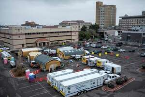 Recently-added tents are stationed at the Texas Tech University Health Sciences Center El Paso parking lot in El Paso, Texas, on Oct. 27, 2020. The number of people hospitalized with the coronavirus has climbed significantly from a month ago, straining cities that have fewer resources to weather the surges. (Joel Angel Juarez/The New York Times)