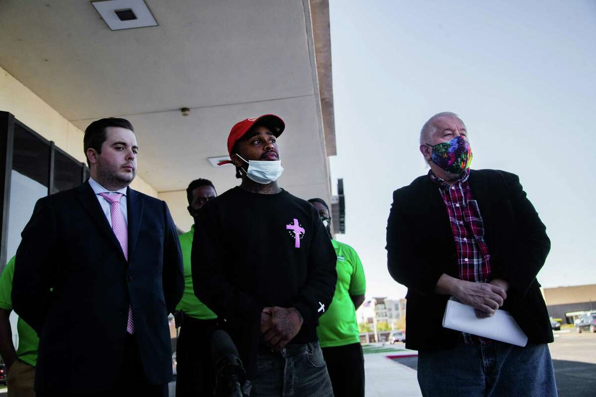 Corey Spiller, 28, talks to the press in front of the Harris County Constable Precinct 7, Monday, Nov. 16, 2020, in Houston. Spiller has filed a federal civil rights suit following an incident in which body camera footage captured him being choked by Precinct 7 Sgt. Jared Lindsay.