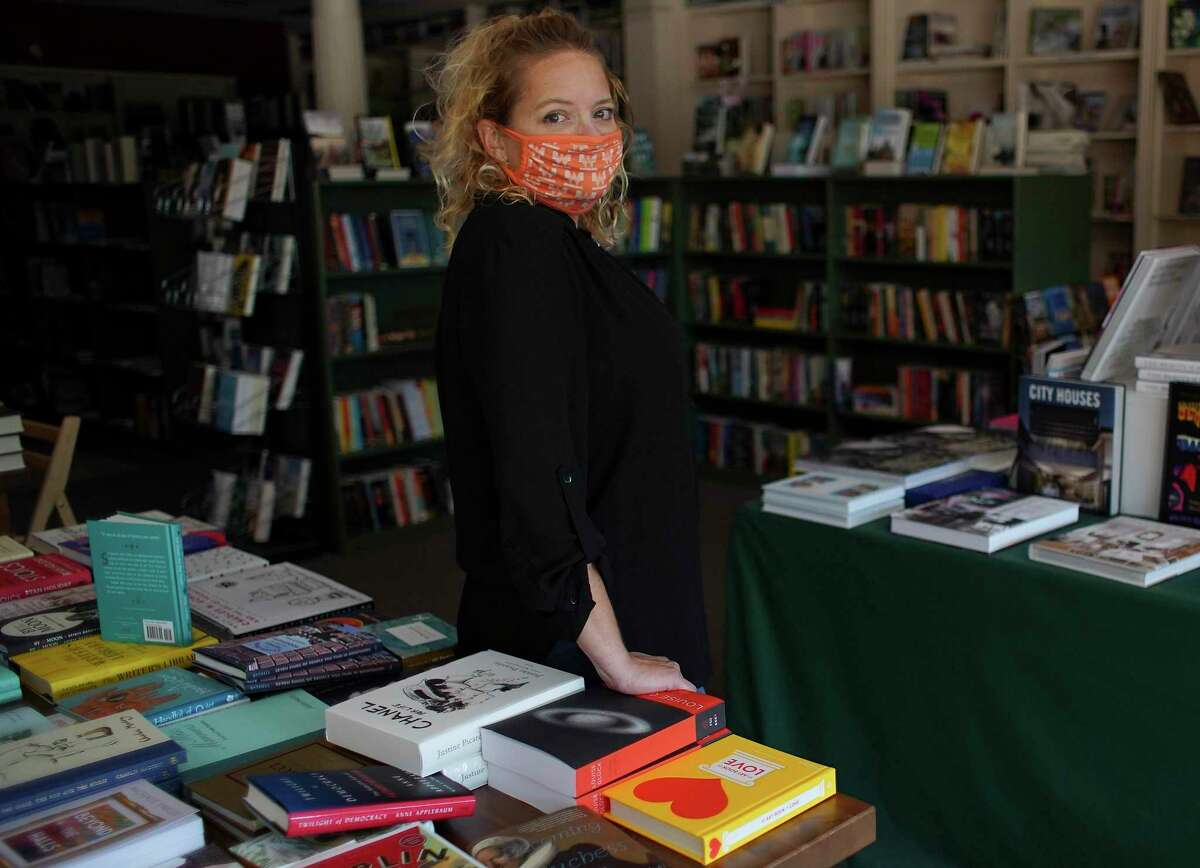 River Oaks Bookstore employee Whitney Andrews Corson in the Houston bookstore on Sunday, Nov. 15, 2020. After nearly forty-seven years, the locally-owned store is scheduled to close at the end of the year.