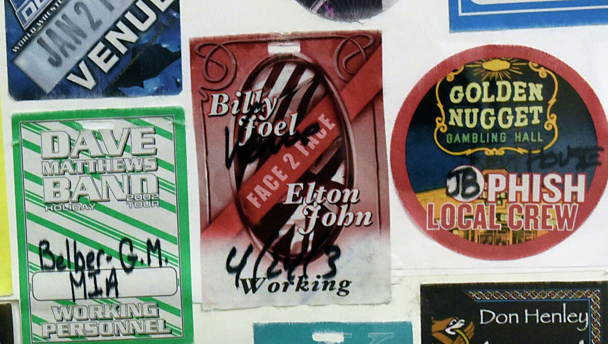 Detail of a collection of 350 backstage passes for shows at the arena that Bob Belber, general manager of the Times Union Center, will be auctioning on Monday Nov. 16, 2020 in Albany, N.Y. He is hoping to raise at least $70,000. He will be donating a portion of proceeds to the 23 full-time Times Union Center employees who were furloughed at the beginning of the pandemic. (Lori Van Buren/Times Union)