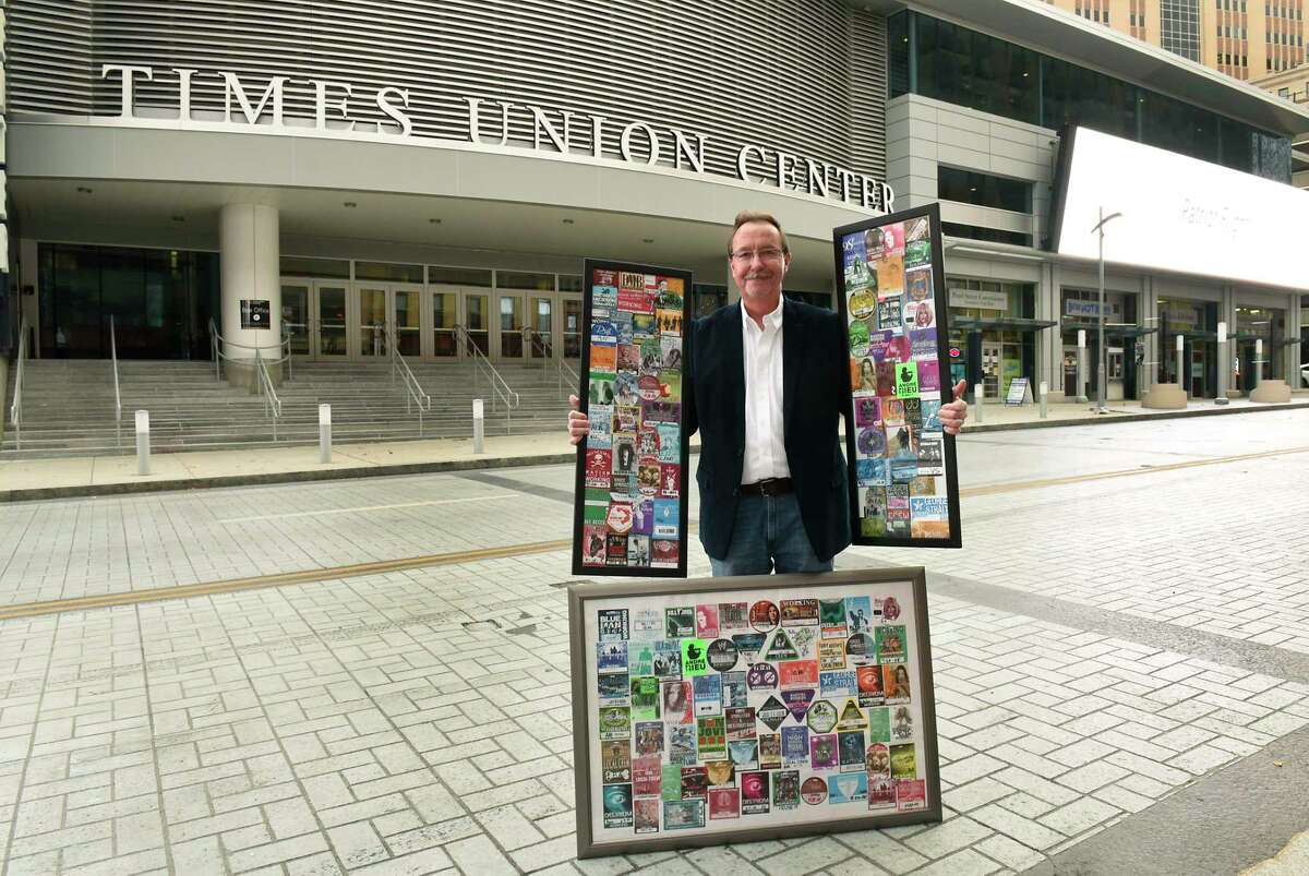 Bob Belber, general manager of the Times Union Center, stands outside the arena with part of his collection of 350 backstage passes for shows at the arena he will be auctioning on Monday Nov. 16, 2020 in Albany, N.Y. He is hoping to raise at least $70,000. He will be donating a portion of proceeds to the 23 full-time Times Union Center employees who were furloughed at the beginning of the pandemic. (Lori Van Buren/Times Union)