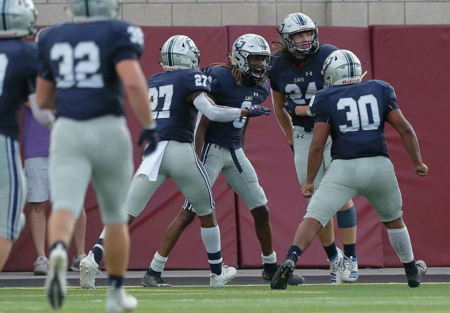 College Park defensive back Marcus Scott II (8) celebrates with teammates after returning a blocked field goal for a 70-yard touchdown to end the second quarter of a District 13-6A high school football game at Woodforest Bank Stadium, Saturday, Nov. 14, 2020, in Shenandoah. Photo: Jason Fochtman, Houston Chronicle / Staff Photographer / 2020 © Houston Chronicle