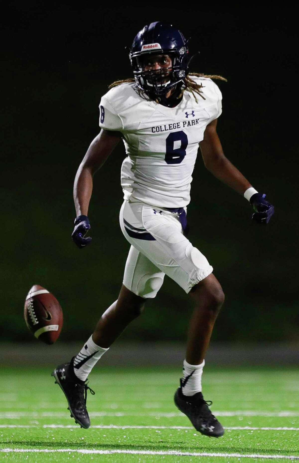 College Park defensive back Marcus Scott II (8) reacts after interepting a pass during the third quarter of a non-district high school football game at Edward Mercer Stadium, Saturday, Oct. 10, 2020, in Sugar Land.