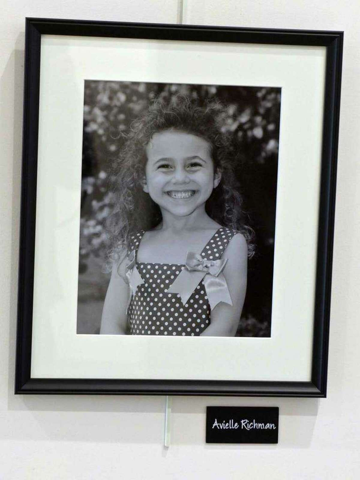 A photograph of Avielle Richman, one of the victims of the Sandy Hook Elementary School shooting, in a gallery in the Newtown Municipal Center on Wednesday, December 13, 2017.