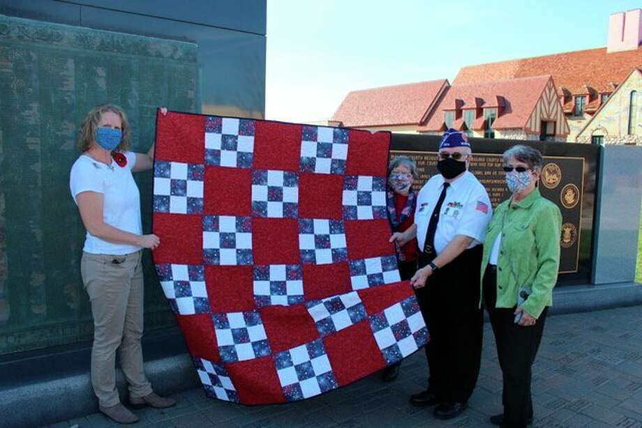 From left, Nancy Pnacek, Fred and Kathy Honerkamp. The John Alden Chapter, Daughters of the American Revolution recently presented a Quilt of Valor to Fred. (Photo provided/John Alden Chapter, Daughters of the American Revolution)