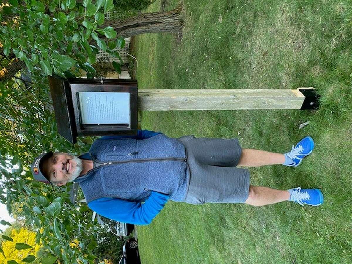 Ben Shaw in front of his Delmar Poetry Box.
