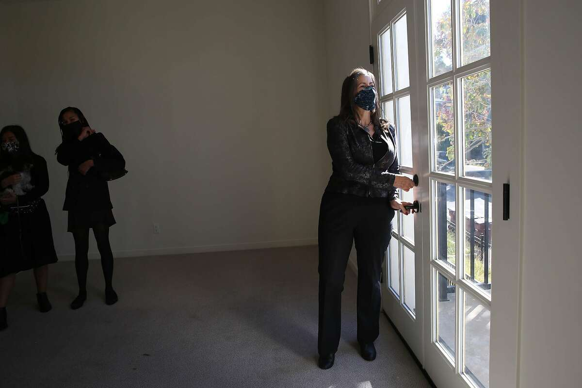 Oakland Mayor Libby Schaaf takes in the view from an apartment at the Paloma in the Oakland hills, where units are being rented to teachers at super-low rates.