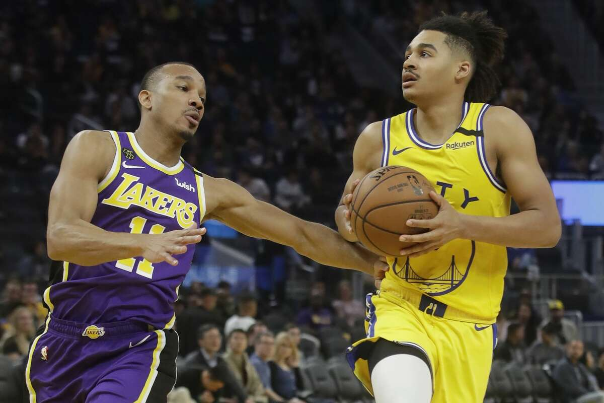 Golden State Warriors guard Jordan Poole, right, is defended by Los Angeles Lakers guard Avery Bradley during the second half of an NBA basketball game in San Francisco, Thursday, Feb. 27, 2020. (AP Photo/Jeff Chiu)