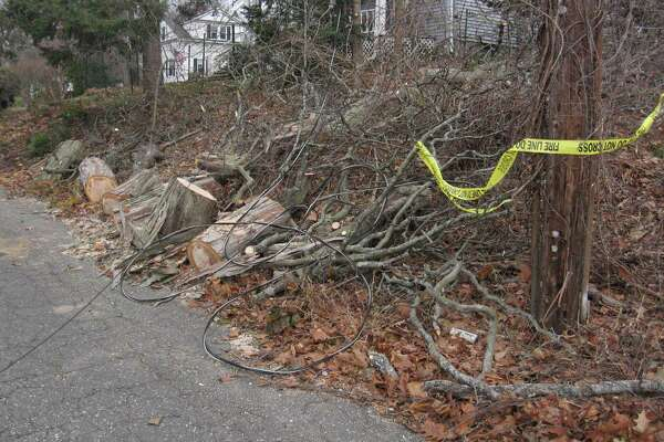 A storm that blew in Sunday night left residents without power and properties and trees damaged in Harwinton and Torrington, as well as towns across the state. Above, fallen debris on Eno Avenue in Torrington.