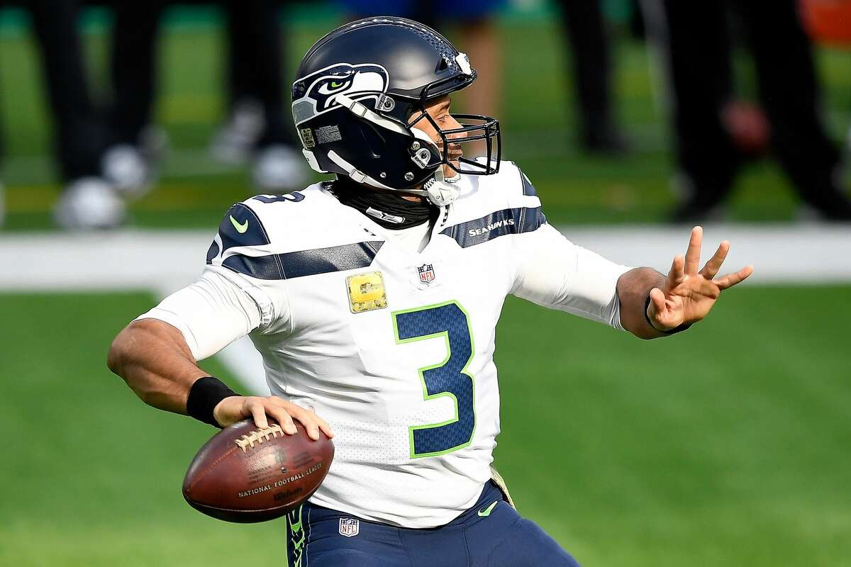 INGLEWOOD, CALIFORNIA - NOVEMBER 15: Quarterback Russell Wilson #3 of the Seattle Seahawks throws against the Los Angeles Rams in the first quarter at SoFi Stadium on November 15, 2020 in Inglewood, California. (Photo by Kevork Djansezian/Getty Images)