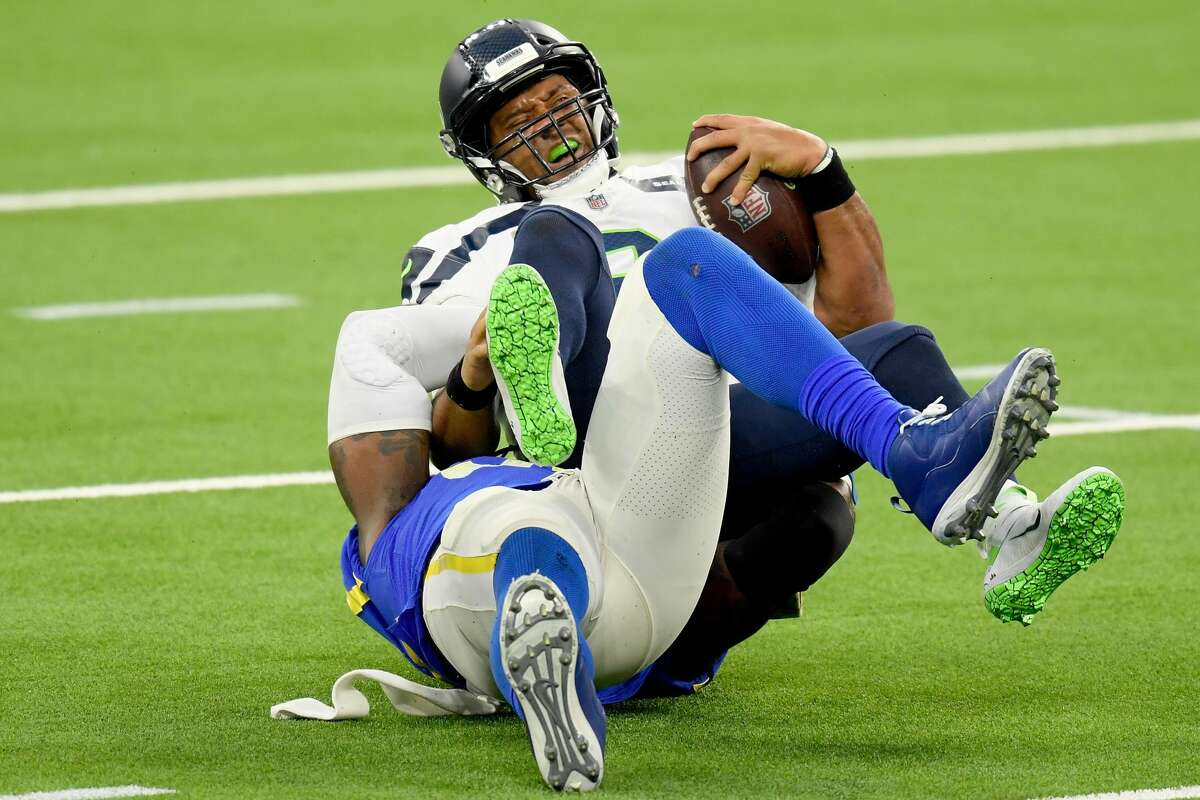 INGLEWOOD, CALIFORNIA - NOVEMBER 15: Quarterback Russell Wilson #3 of the Seattle Seahawks is sacked by Michael Brockers #90 of the Los Angeles Rams in the fourth quarter at SoFi Stadium on November 15, 2020 in Inglewood, California. (Photo by Harry How/Getty Images)