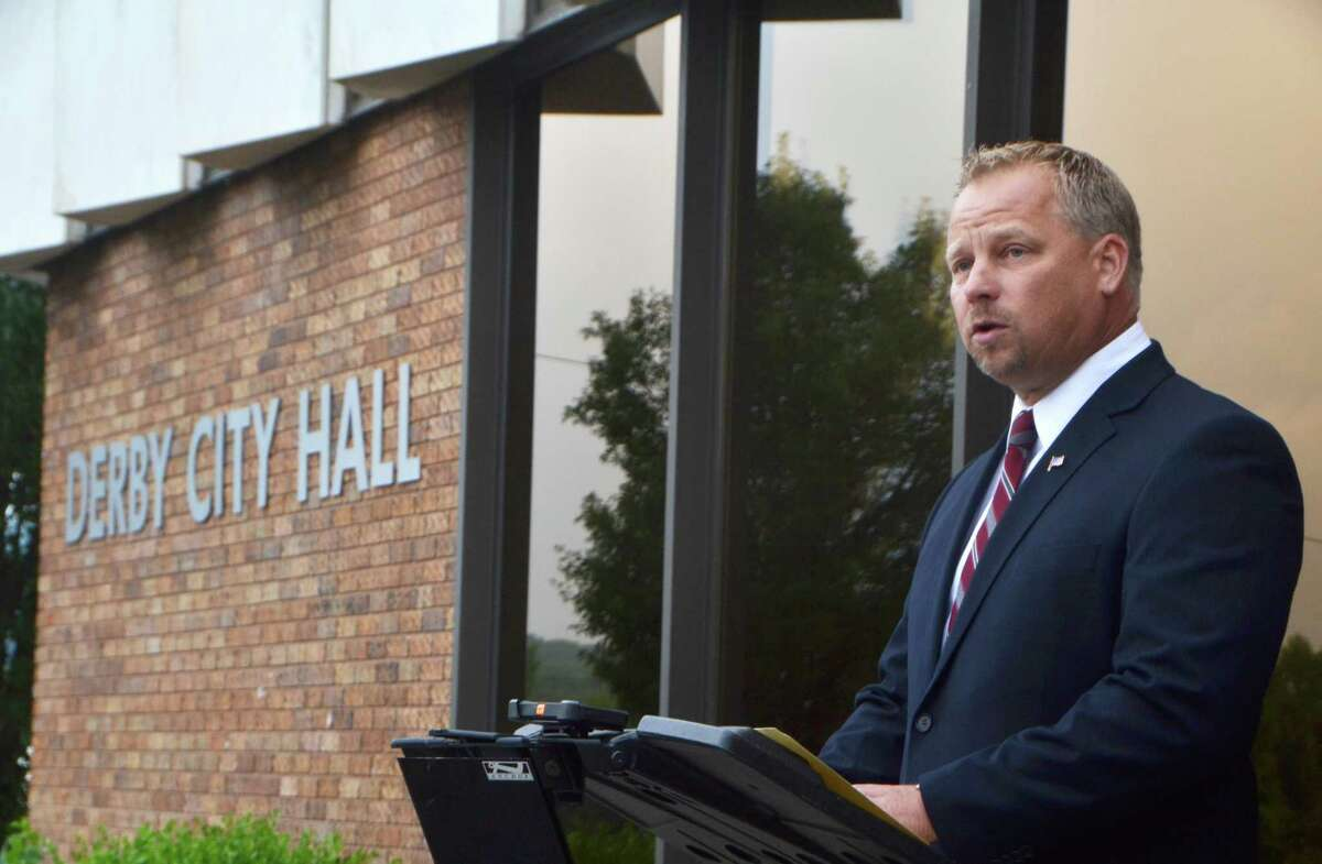 Derby Mayor Richard Dziekan said City Hall will open to the public Tuesday; the public library has reverted to curbside service only after positive COVID-19 tests from two city employees.