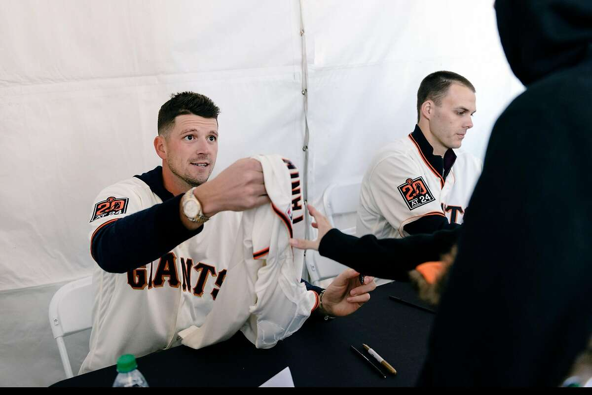 Giant's pitcher Drew Smyly signs autographs for fans during the San Francisco Giants Fan Fest event at Oracle Park in San Francisco, California, U.S., on Saturday, Feb. 8, 2020.