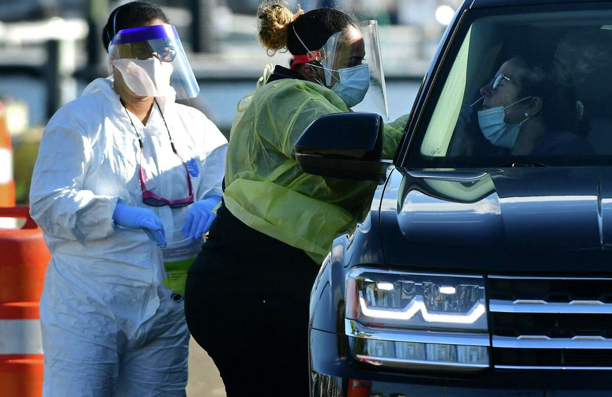 Day Street Community Health Center staff conduct drive-through and walk-up COVID-19 testing operations at Veteran's Park on Saturday The ramped-up testing is part of the city's response to COVID cases increasing.