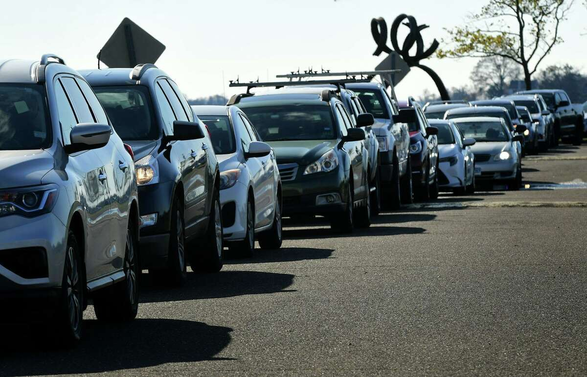 Cars wait in line for drive-through and walk-up COVID-19 on Saturday, November 14, 2020, in Norwalk, Conn.