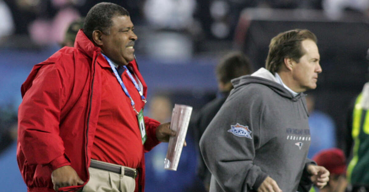 New England Patriots' Defensive Coordinator Romeo Crennel and Head Coach Bill Belichick jog onto the field prior to the start of the game. New England Patriots face the Philadelphia Eagles in Super Bowl XXXIX at Alltel Stadium in Jacksonville, FL on Feb. 6, 2005. (Photo by Barry Chin/The Boston Globe via Getty Images)