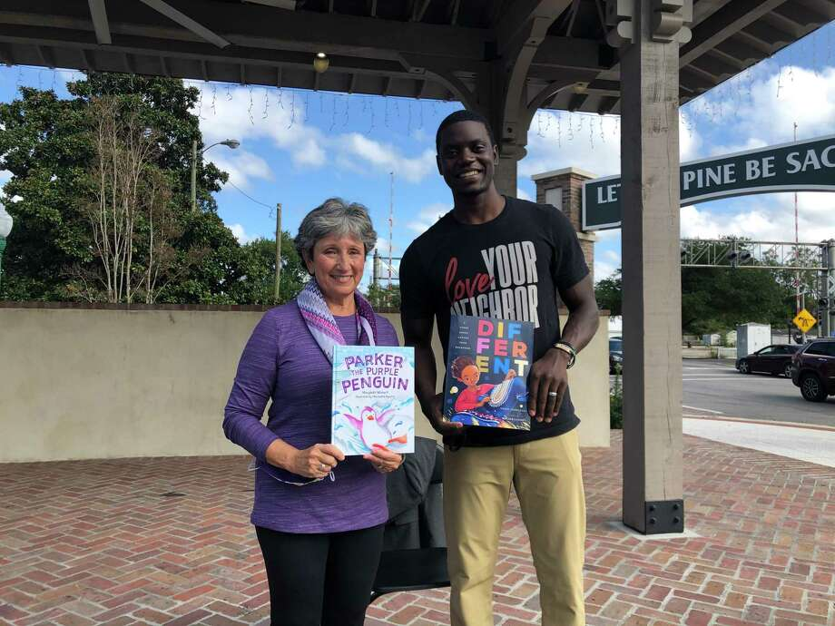 "Marybeth Wishart with Chris Singleton at ""Parker the Purple Penguin"" book launch in South Carolina. Photo: Margaret Densley / Contributed Photo"