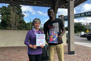 """Marybeth Wishart with Chris Singleton at """"Parker the Purple Penguin"""" book launch in South Carolina."""