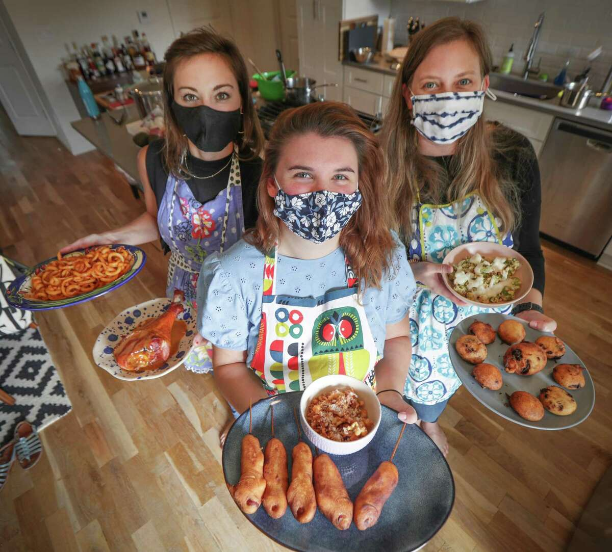 Caitlin Griffith, from left, the Houston Chronicle's Emma Balter and Lauren McDowell made State Fair food at McDowell's home.