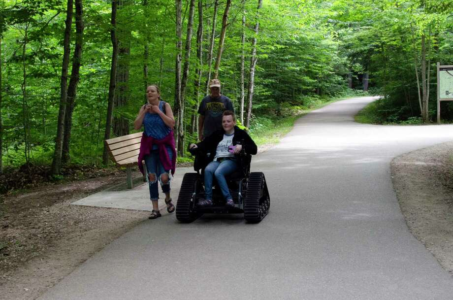 A visitor uses a track chair at Tahquamenon Falls State Park in northeastern Luce County. (Courtesy photo/Michigan Department of Natural Resources)