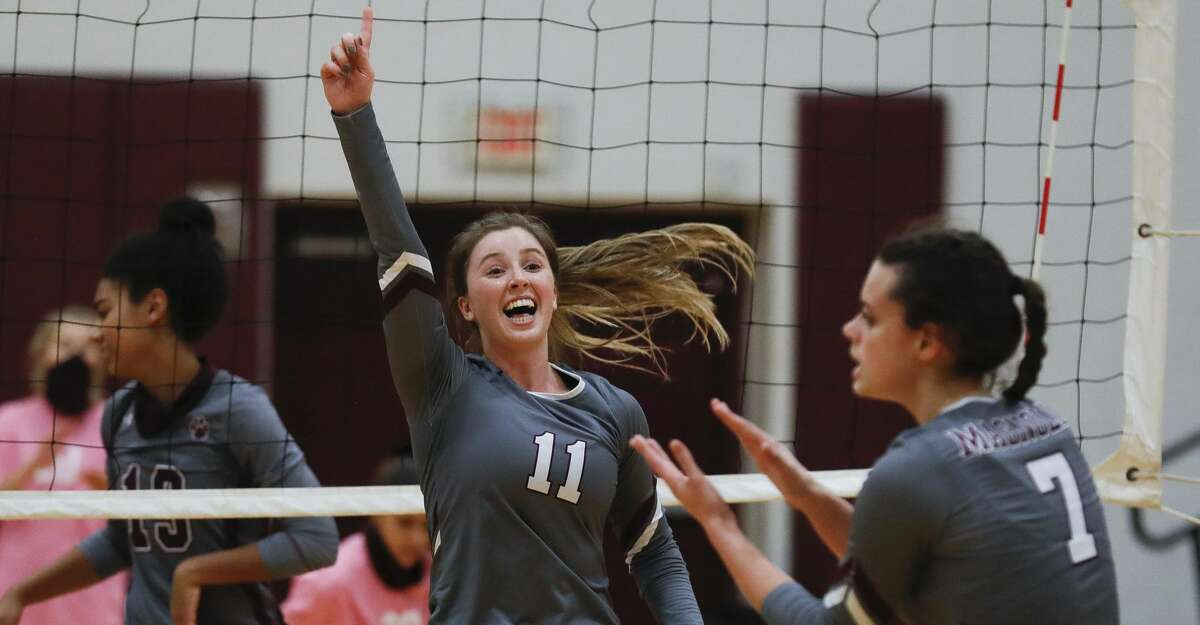 Magnolia setter Faith Lynch (11) reacts after a point by outside hitter Marissa Moffatt (7) during the first set of a District 19-5A high school volleyball match at Magnolia High School, Tuesday, Nov. 10, 2020, in Magnolia.