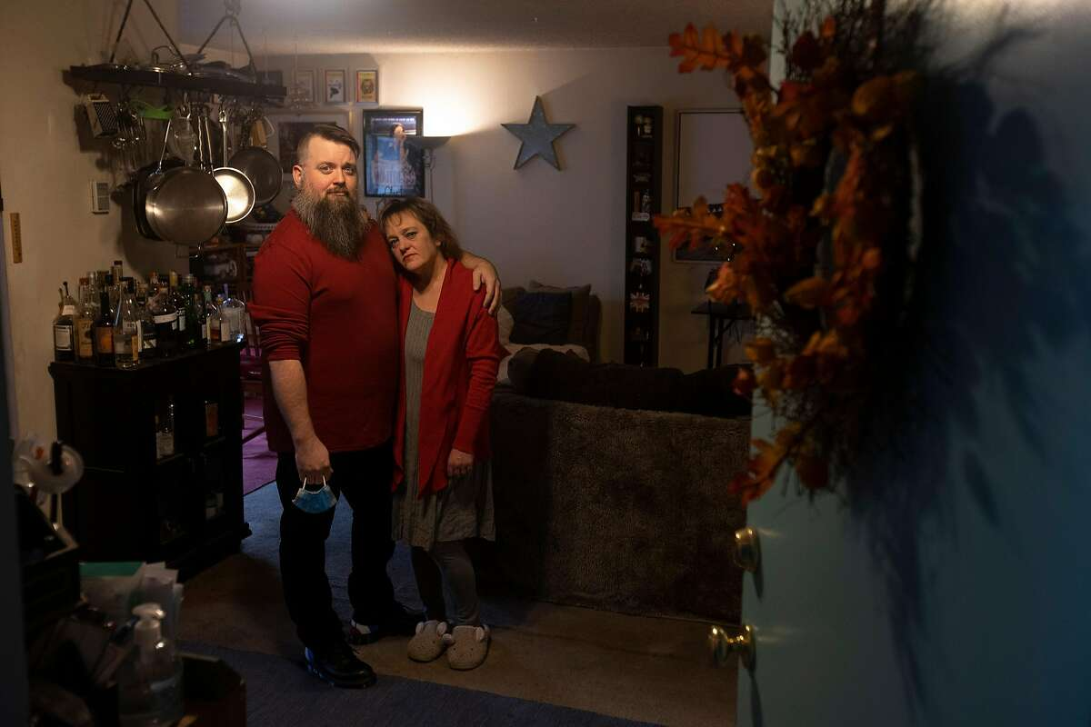 Joey and Jen McDaniel in their Menlo Park home, where they would usually celebrate Thanksgiving with friends. They will celebrate alone together as coronavirus cases skyrocket.