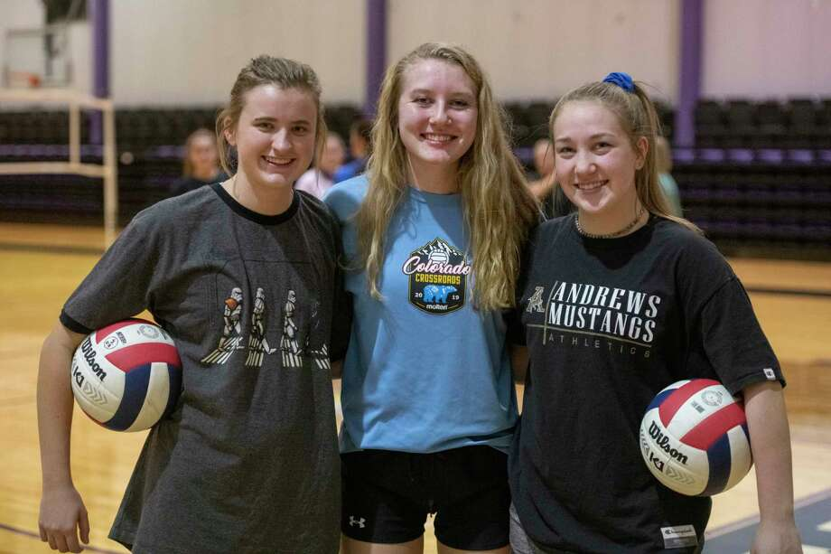 Midland Classical Academy team leaders, Kacy Miller, Marin Casey and Kenna Bayley 11/16/2020 during practice as the volleyball team prepares for a trip to the state semifinals. Tim Fischer/Reporter-Telegram Photo: Tim Fischer, Midland Reporter-Telegram