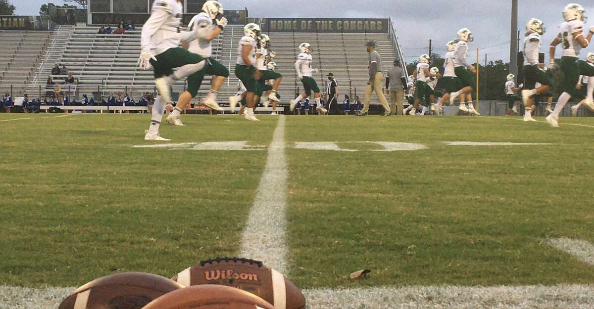 The Woodlands Christian Academy football team warms up prior to its game against Frassati Catholic on Friday, Oct. 23, 2020 at Northland Christian in Houston.