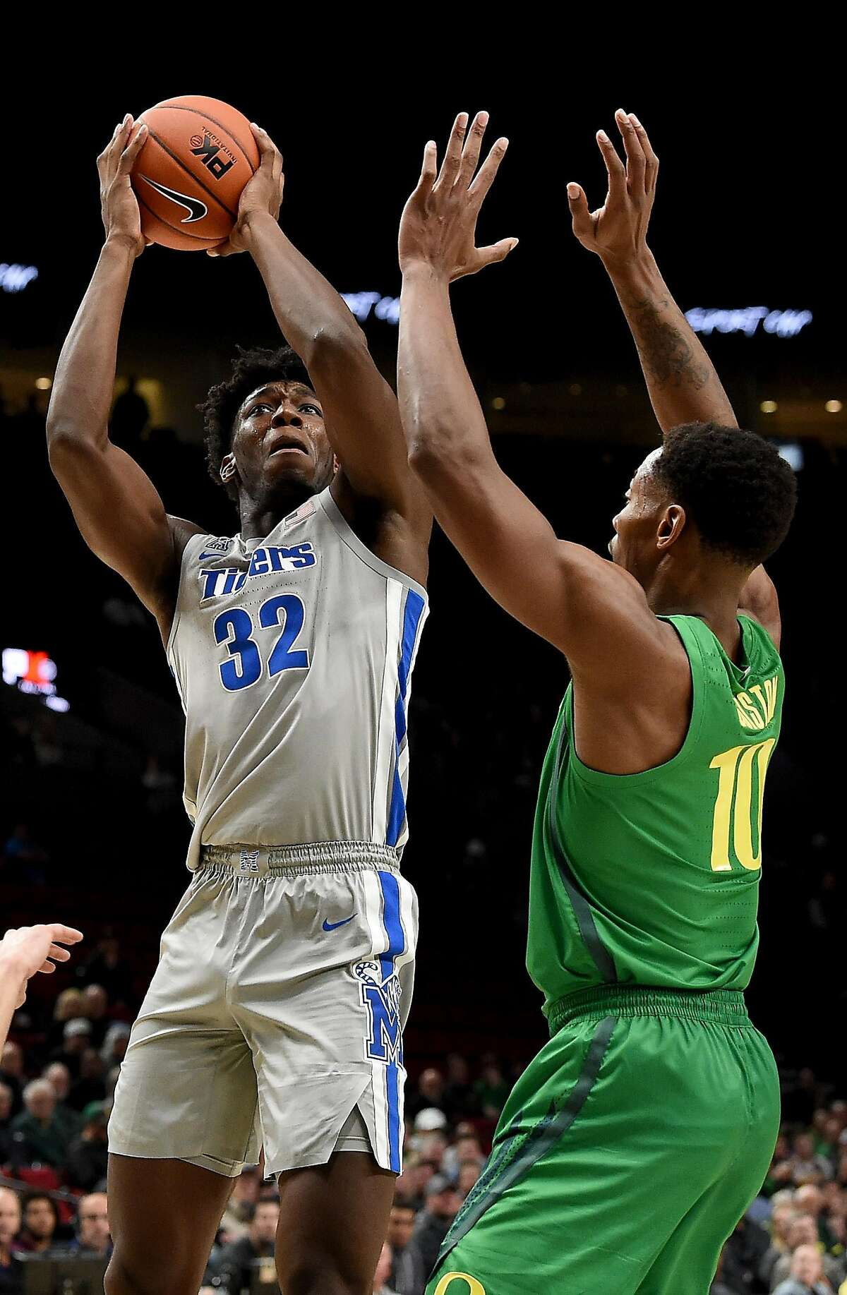 PORTLAND, OREGON - NOVEMBER 12: James Wiseman #32 of the Memphis Tigers shoots the ball over Shakur Juiston #10 of the Oregon Ducks during the first half of the game at Moda Center on November 12, 2019 in Portland, Oregon. ~~