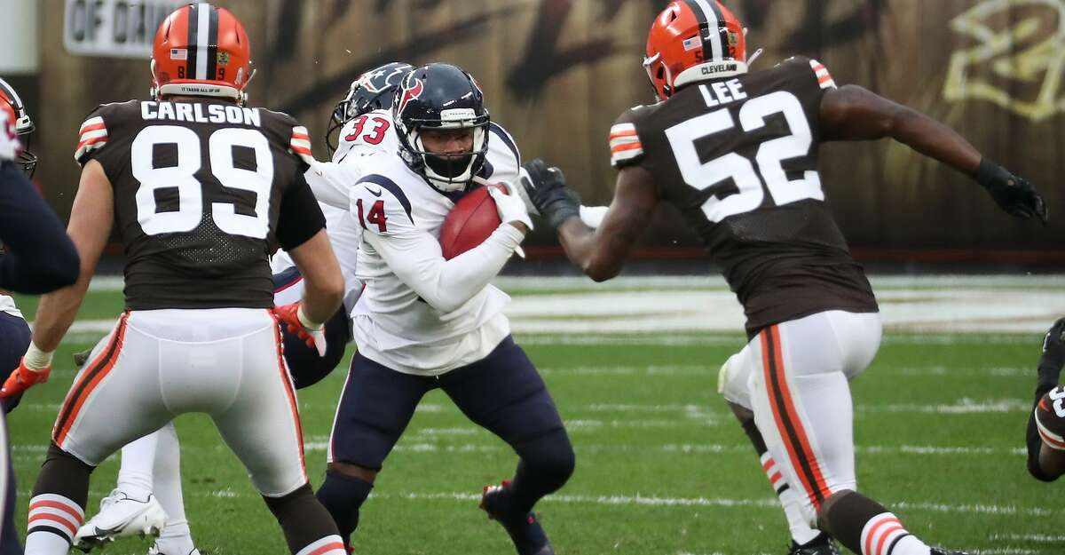 Houston Texans wide receiver DeAndre Carter (14) returns a punt against the Cleveland Browns during the third quarter of an NFL football game at FirstEnergy Stadium Sunday, Nov. 15, 2020, in Cleveland.